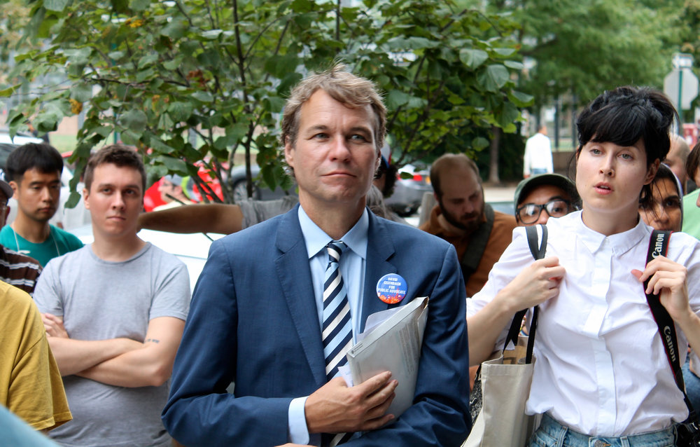 David Eisenbach, who teaches history at Columbia University, is a candidate for Public Advocate in the Democratic Party primary election in September. He joined the Queens Gentrification Tour to promote his campaign promise to help small businesses win rent protections. Source : Louis Flores/Progress Queens