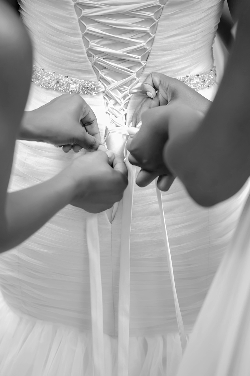 Corset lace dresses are beautiful, but a pain to get in to. Learn how to do this well before the wedding day. It'll save you time and lots of headaches.
