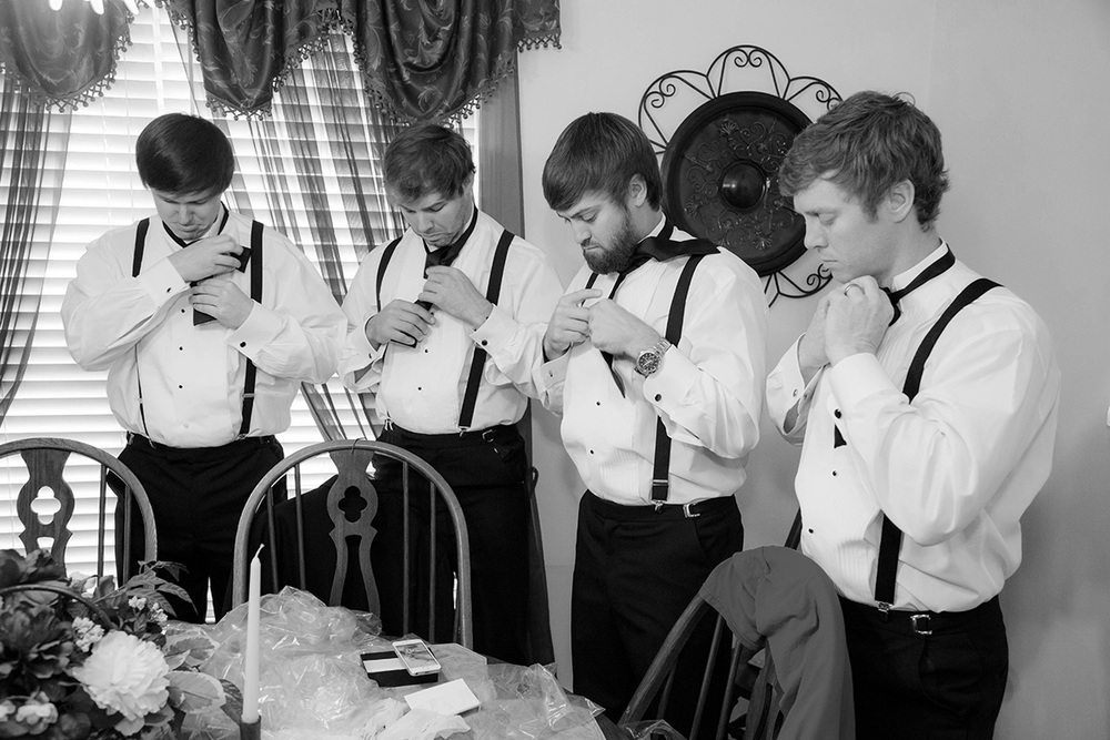The guys with their handy iPhone learning How to Tie a Bow Tie. I just love this photo!