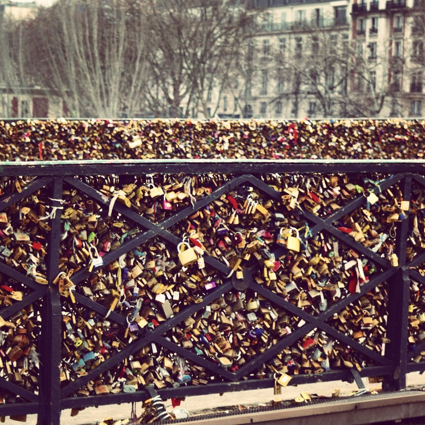 Just a portion of the locks that span both sides of the bridge from one end to the other. The locks have the names of those in love, a date, and sometimes a message.