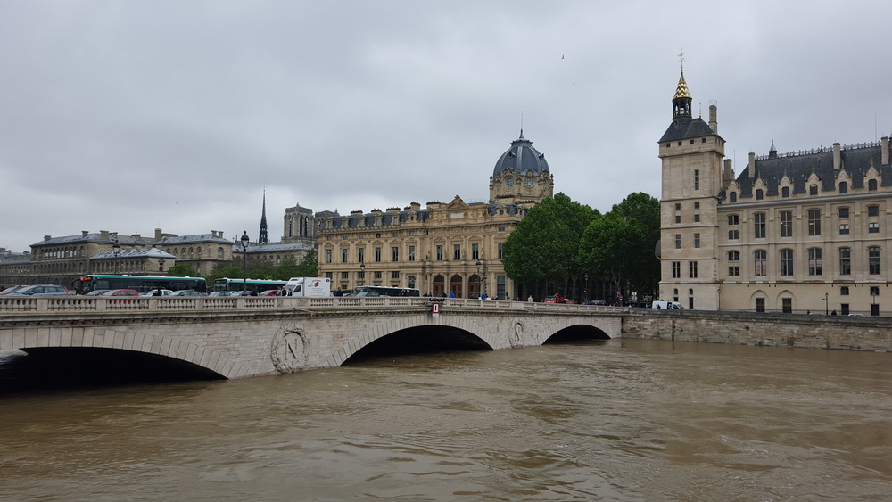 Close to the Palais de la Justice. The water is almost at the top of the arches.