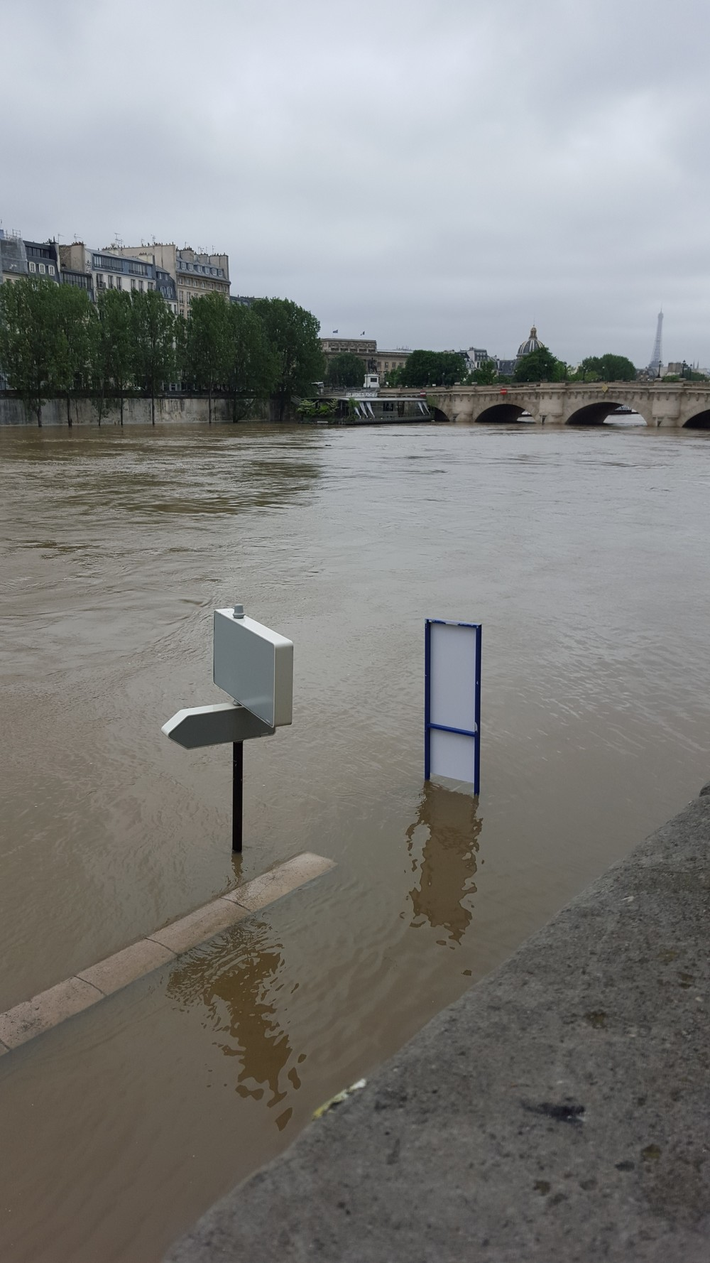 Those signs are actually on part of the roadway that travels the length of the Seine.