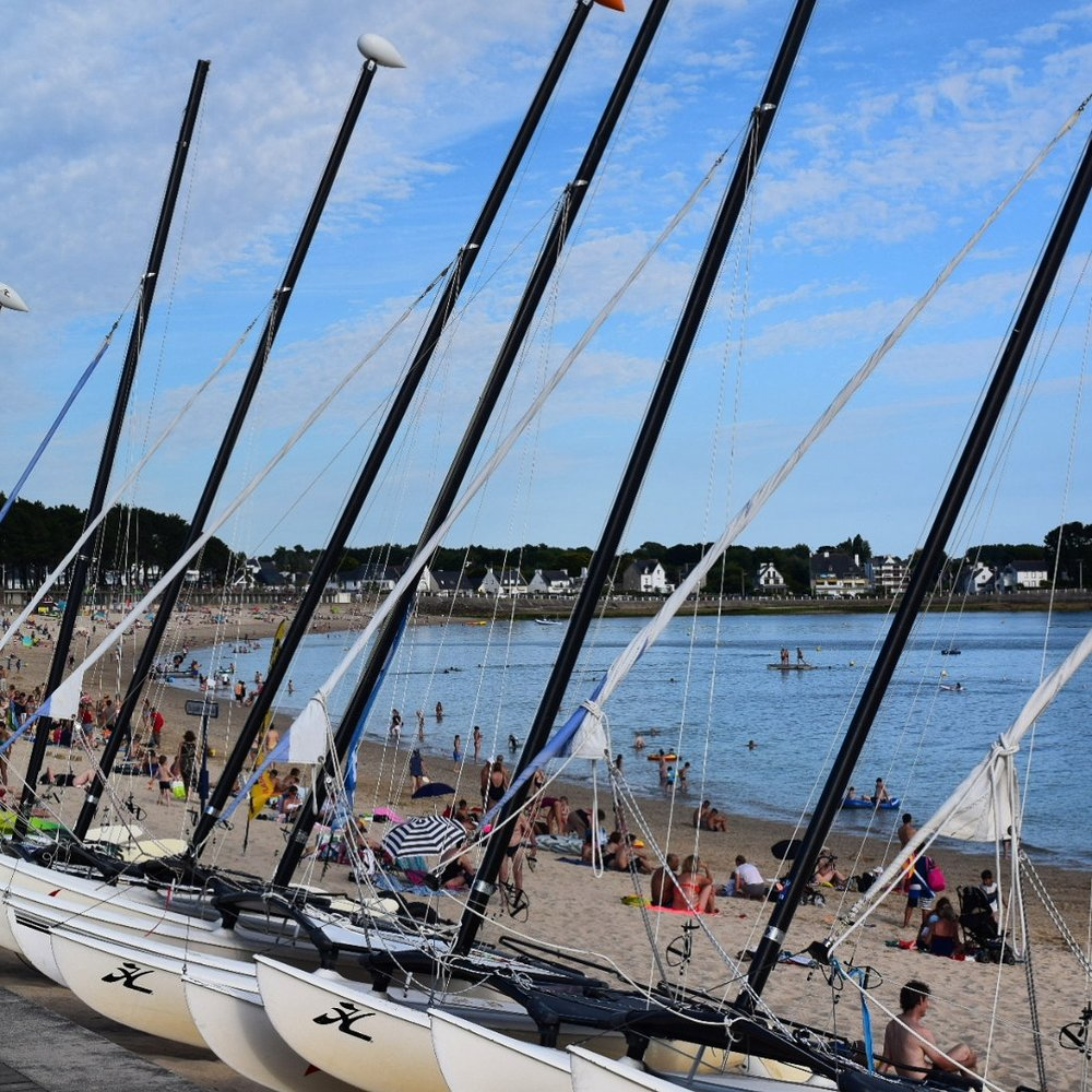 Some of the sailboats for hire lining the beach.