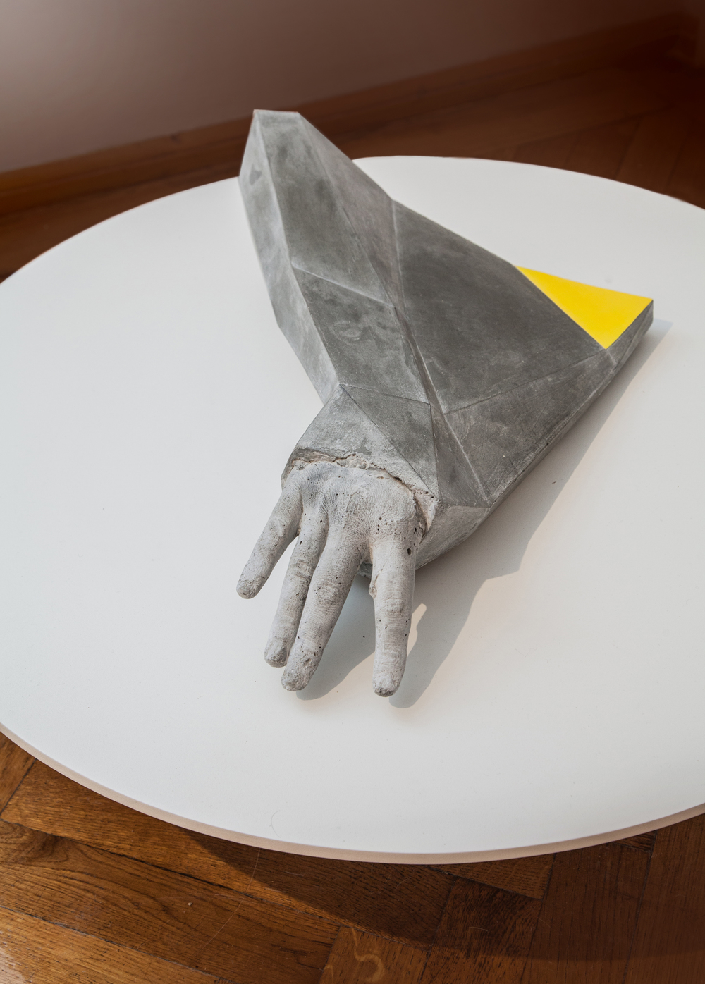 YELLOW TRIANGLE (2013) CONCRETE/METAL/PAINT/WOOD 74 X 74 X 30 CM