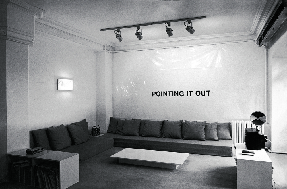 POINT IT OUT (1976-1977) ADHESIVE VINYL LETTERS, SITE SPECIFIC