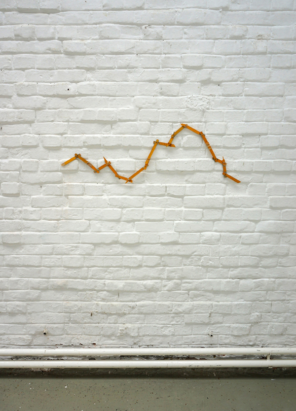 REMADE TO MEASURE - YELLOW (2014) Broken wooden ruler, rubber bands
