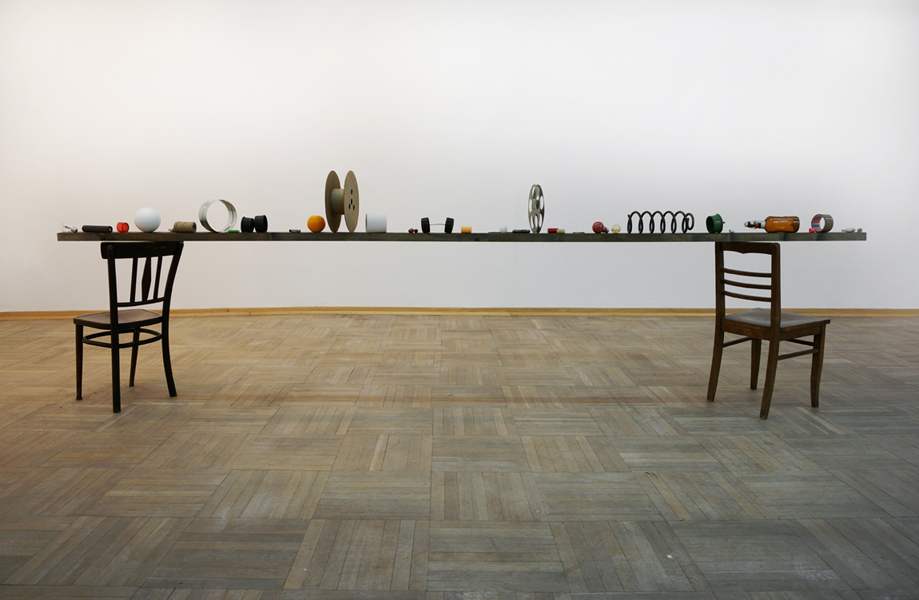 BALANCE BEAM #0715 (2015) Wooden chairs, wooden beam, various objects