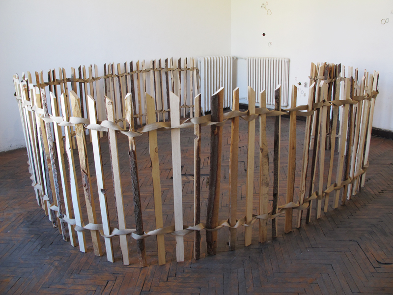 FENCED OFF AREA  (2012) Reclaimed wood, canvas webbing, staples Installation view: The 53rd October Salon, Belgrade, Serbia