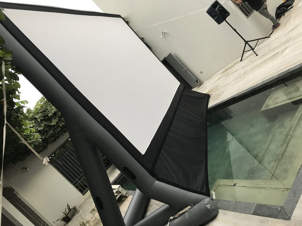 An inflatable screen, over water.  What could possibly go wrong?