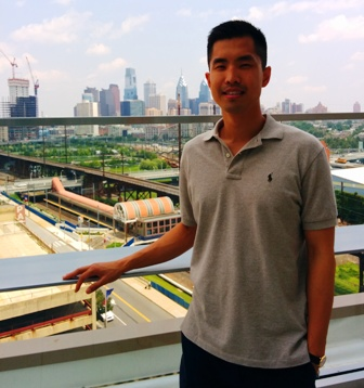 Jason on the Henry A. Jordan M'62 Medical Education Center rooftop balcony with a view of Penn Park and the Center City skyline.