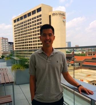 Jason on the Jordan Center roof in front of Penn Tower.