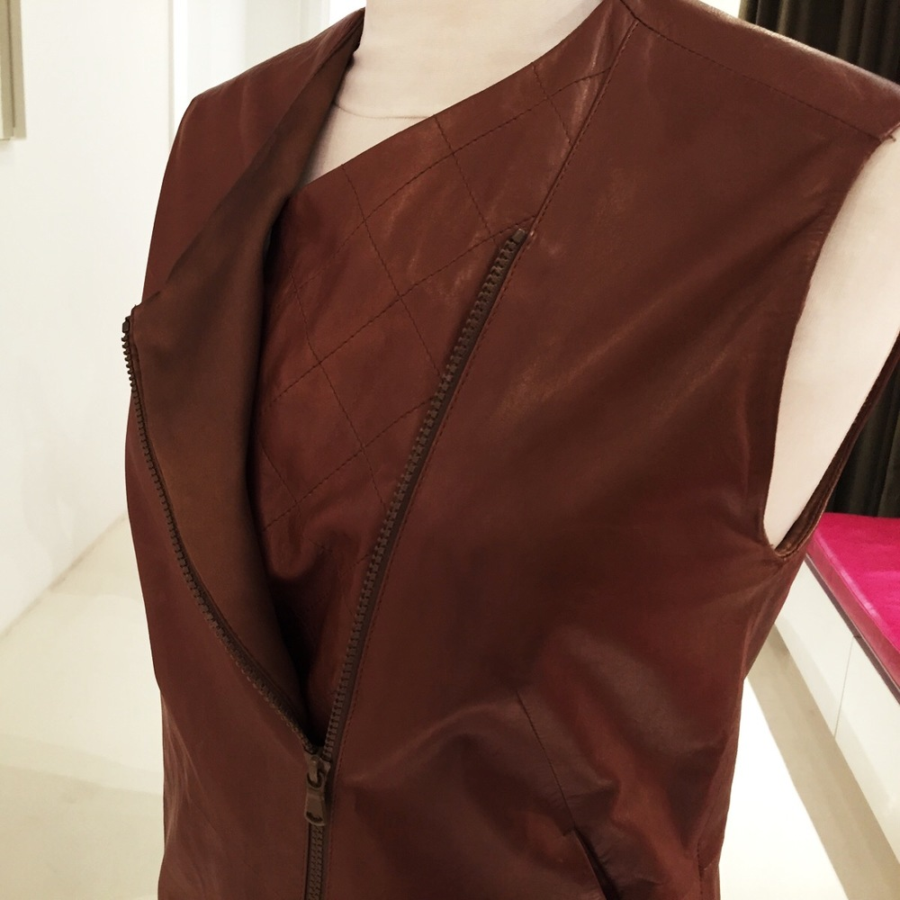 ... We have to remove the excess on the lining hem and padding inside the jacket.