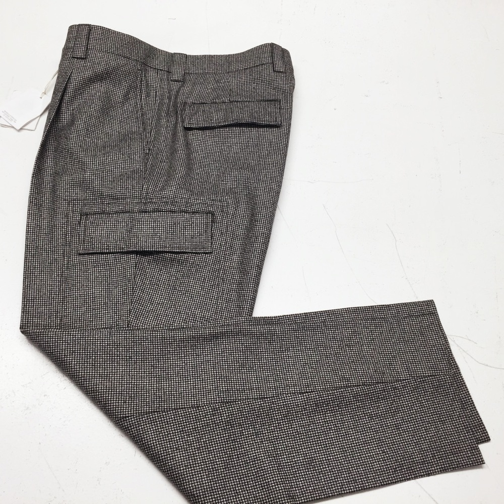 We took in waist Brunello Cucinelli houndstooth menswear trousers at centre back...