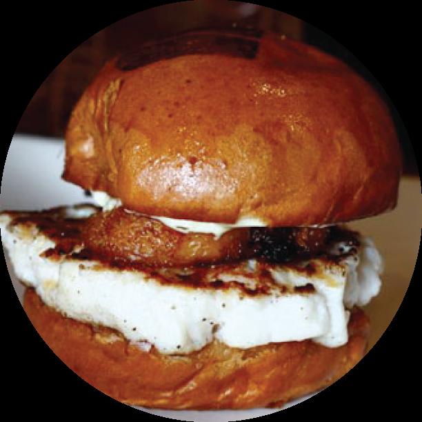 BACON-WRAPPED SCALLOP BURGER- MARINA DISTRICT scallop patty, topped with crispy pork belly, sweet chili sauce & yuzu garlic aioli