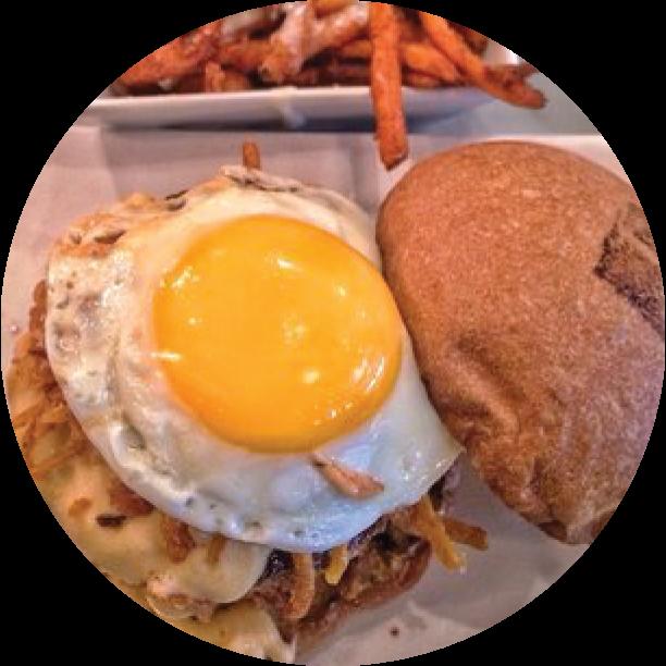 BREAKFAST BURGER- STUDIO CITY signature blend of beef patty, over-medium egg, beer-cheddar, bacon lardons, smoked-salt onion strings, smashed cheesy tots, mustard spread