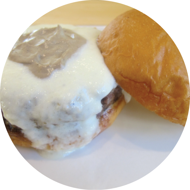 THE GROVE TRUFFLE BURGER- THE GROVE signature blend of beef patty, Parmesan fondue, topped off with The Grove special truffle sauce