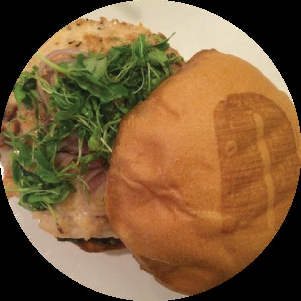 LE CORDON BLEU BURGER- PASADENA braised chicken patty stuffed with prosciutto, bacon & Mornay cheese sauce, lemon cream spinach spread, & micro herb salad with whole grain mustard vinaigrette