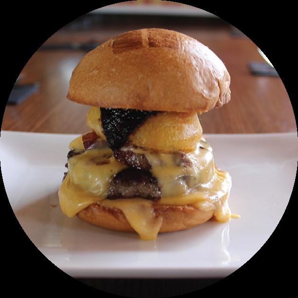 THE SHOW BURGER - BURBANK Hak's BBQ sauce, crispy onion ring, bacon lardons, beer-cheddar