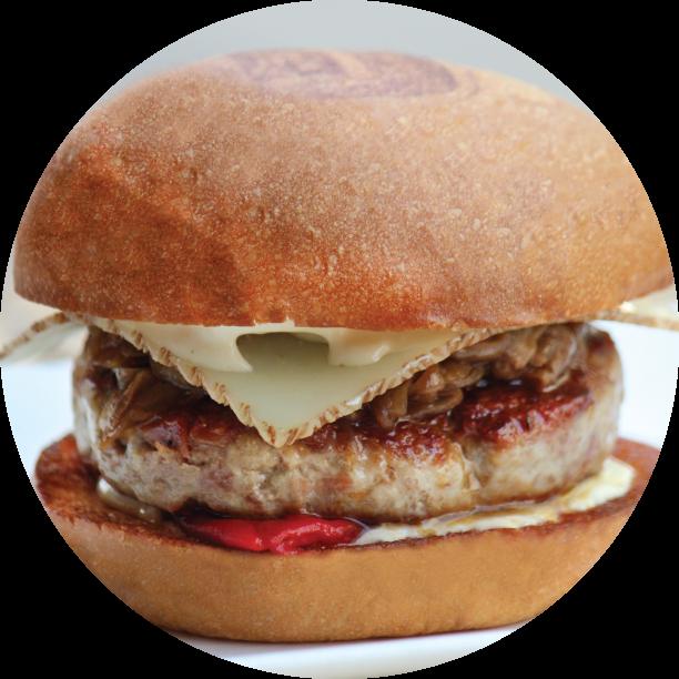 JOSÉ ANDRÉS BURGER- SLS LAS VEGAS pork & cured ham patty, piquillo pepper confit, caramelized onion, manchego cheese, roasted garlic aioli