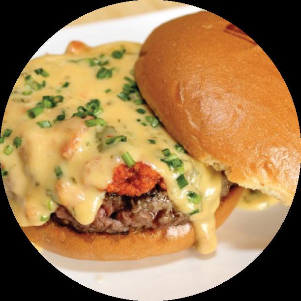 QUESO FUNDIDO- OAKLAND our signature burger topped with queso fresco, chorizo sauce, & cilantro