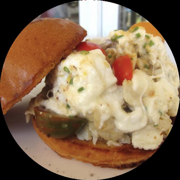 LEMON MISO CRAB MELT- LAGUNA BEACH jumbo lump crab with burrata cheese, baby heirloom tomatoes, with a lemon miso crab dressing
