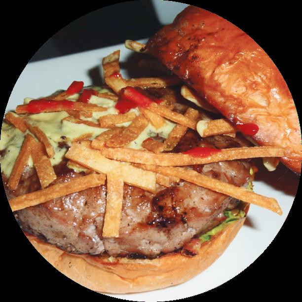 CARNITAS BURGER- LOS FELIZ house made carnitas with fresh ground pork, guajillo sauce, jalapeño sour cream, tortilla crisps