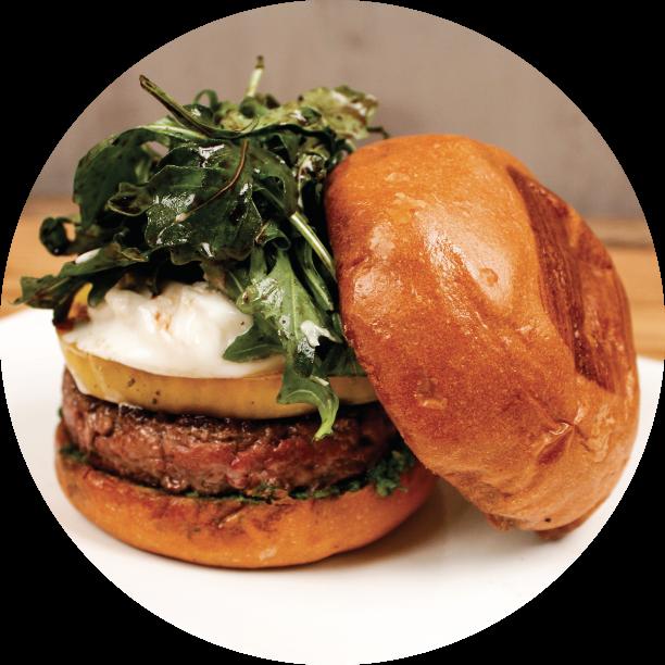 CAPRESE BURGER- SOMA DISTRICT signature blend of beef patty, basil almond pesto, heirloom tomatoes, burrata cheese, arugula basil blend, balsamic truffle reduction