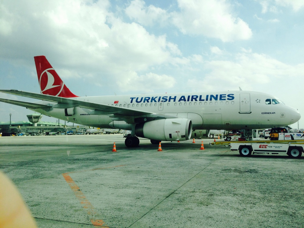 "Our plane was parked next to this one in the ""plane parking lot"" that stood in for gates in Istanbul."