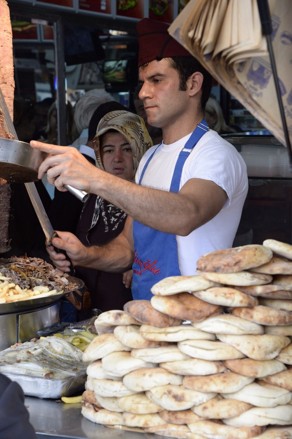 A cook prepares kebap at a stall