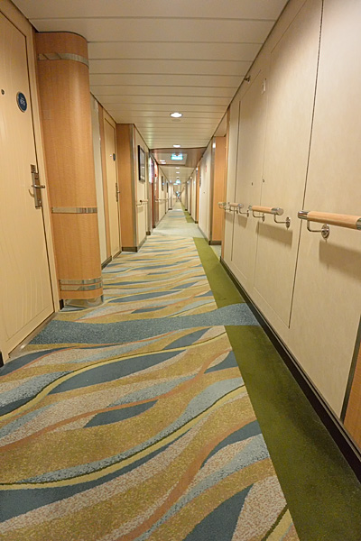 Cabin hallways are wide and bright, doors are recessed along the hallway, minimizing luggage clutter on departure day, and cleaning carts.