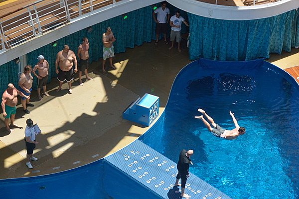 Passenger participation games at the Aqua Theater pool