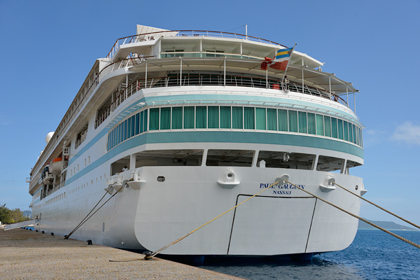 At Raiatea with the sports platform closed up, a view of the L'Etoile dining room on deck 5 (glass windows), La Verandah dining room on deck 6 with outdoor aft seating, aft cabins on deck 7, and La Palette Lounge on deck 8.