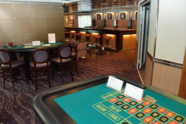 The Casino and Piano Bar; through the small glass door on the right is a room with a few slot machines.