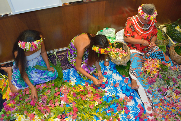 In the area alongside L'Etoile dining room, local women make leis, and heis with guests on Polynesian night