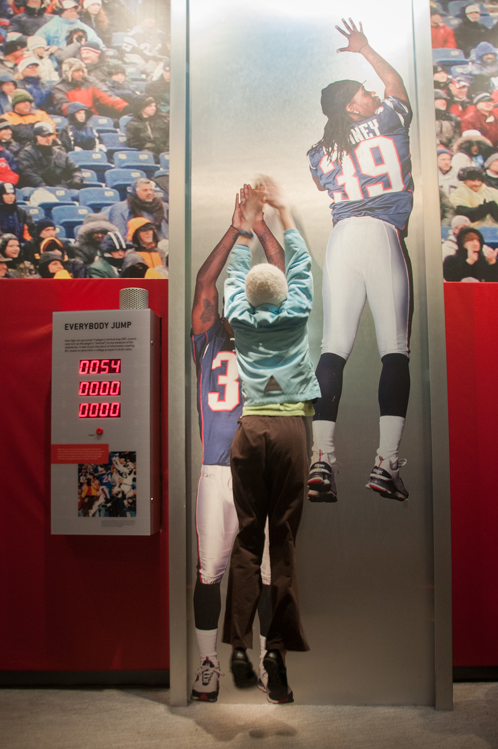 A young fan tries her skills in one of the interactive exhibits of The Hall at Patriot's place.