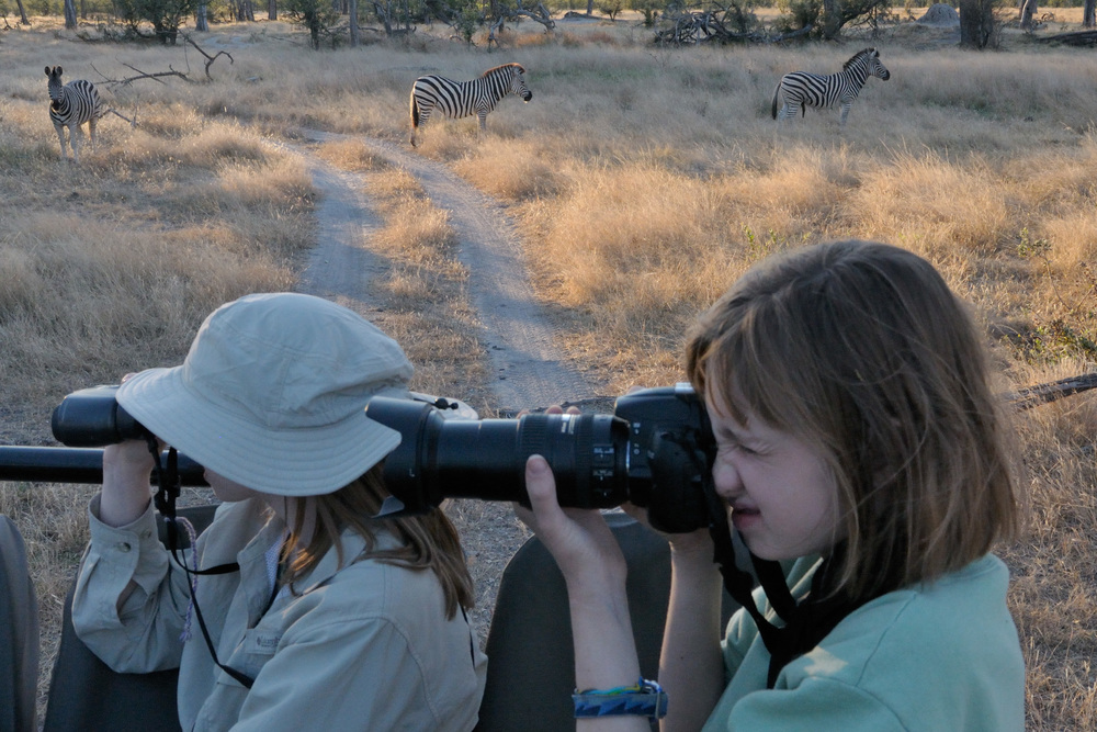 Learning how to use binoculars and a camera at the zoo prepared our children for a lifetime trip to Botswana