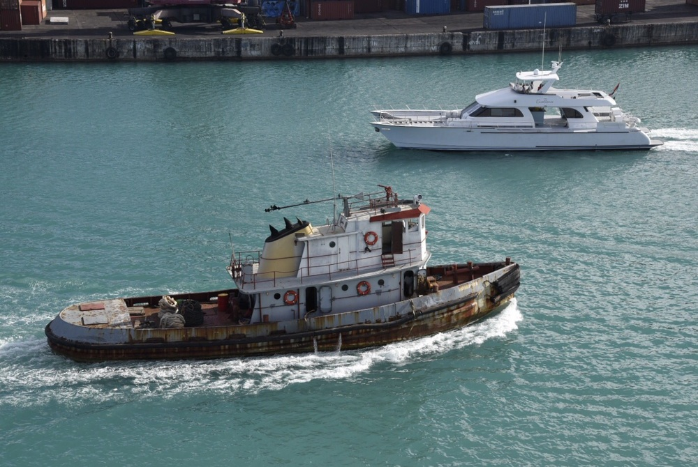 A tug and a motor yacht