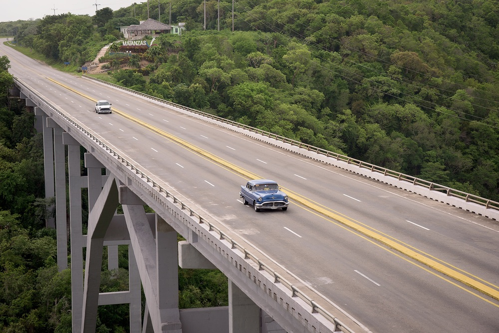 The main road out from Havana to Matanzas features a huge 4 lane bridge, the Bacunaygaua Bridge spanning the Yumuri River. Despite this being the main east/west route into Havana, Jeff found he had to be patient to photograph it with a vehicle on the span.