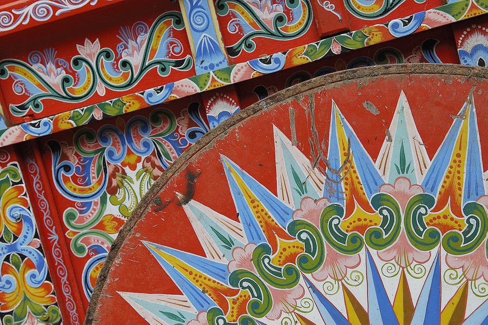 A detail of a colorfully pained ox cart, for which Costa Rica is known.