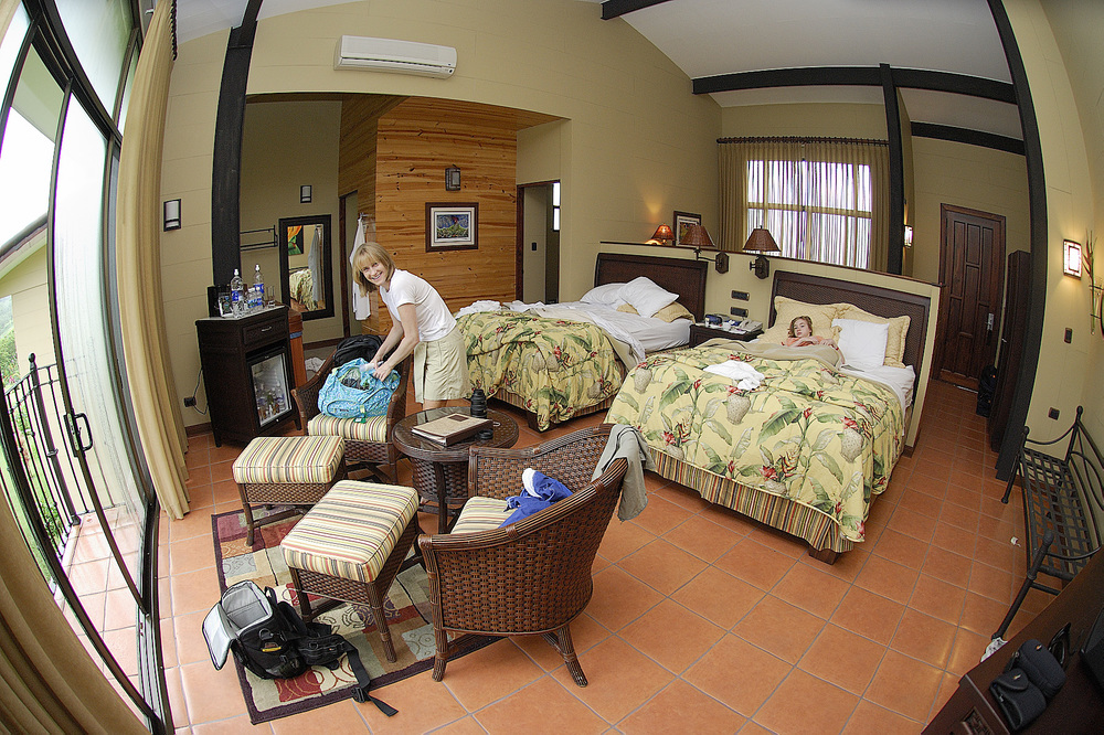 Our room at the Arenal Kioro, with hot tub (behind the fridge), and panoramic windows overlooking the Volcan Arenal, which was active, but often cloud covered during our visit.