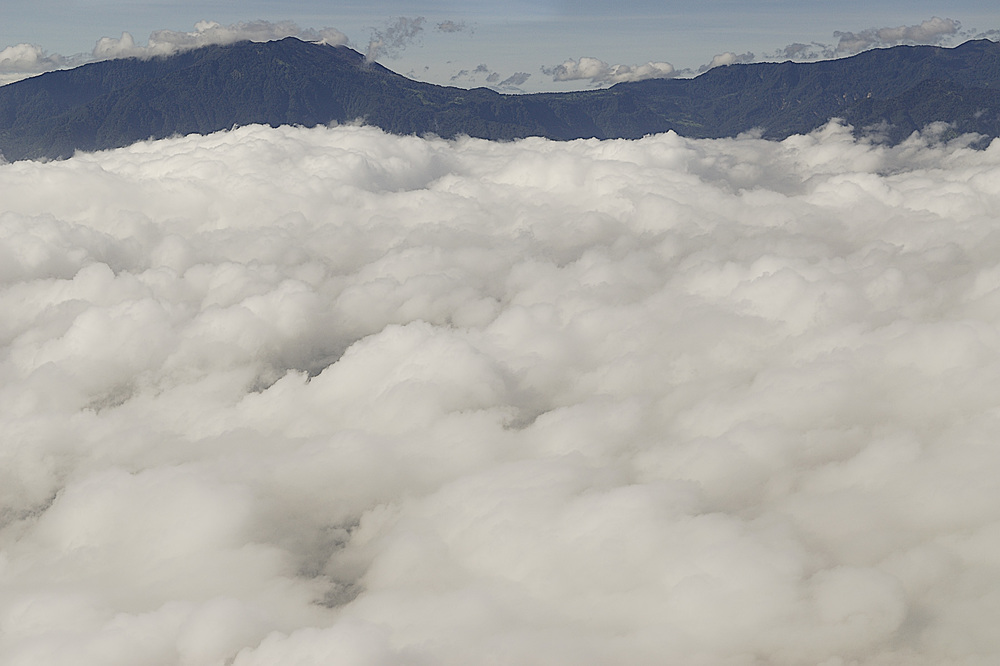 Above the clouds, but not above the mountains and volcanoes.