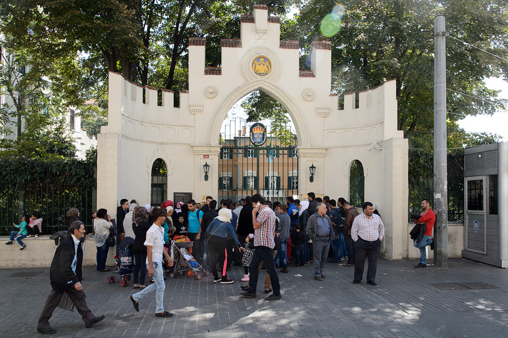 A refugee crisis was just beginning in Istanbul during our late 2014 visit; here refugees seeking visas begin lining up at the Swiss Embassy before it opens.