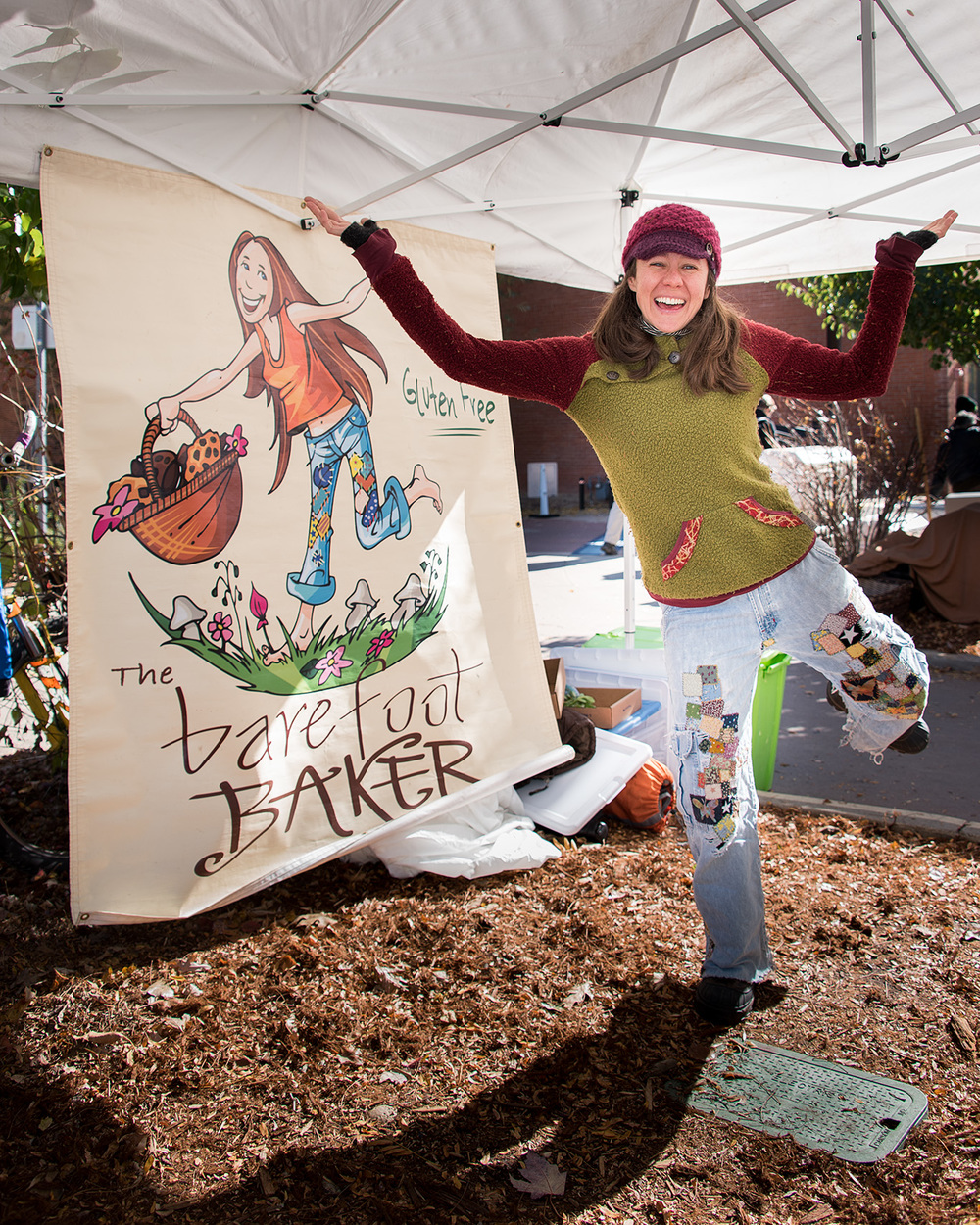 Natasha, wearing her favorite patchwork jeans at her gluten free baked goods booth at the Boulder County Farmers Market