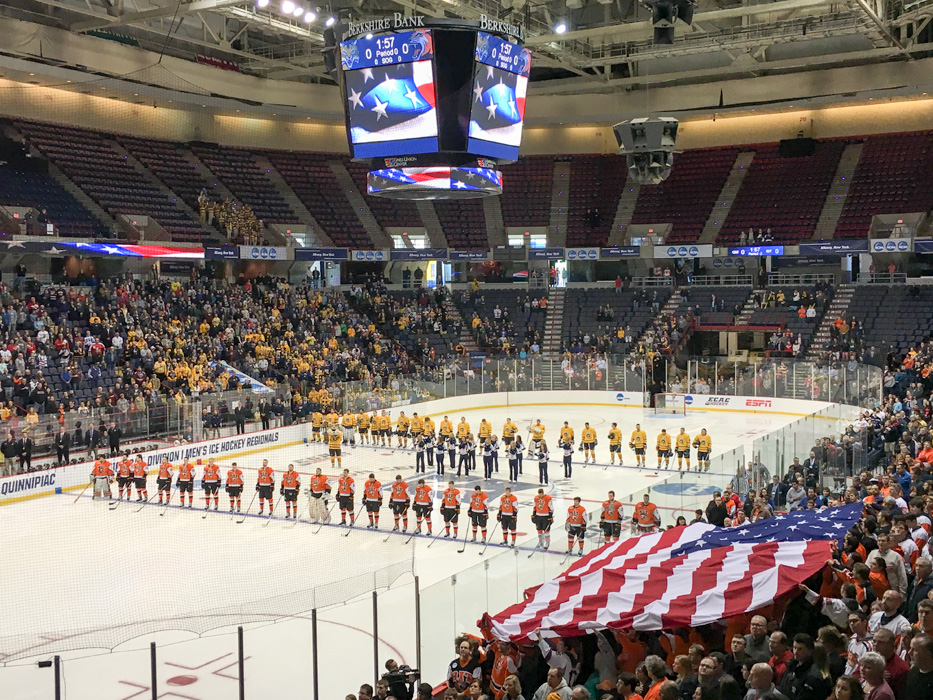 Teams meet at center ice for the National Athem.