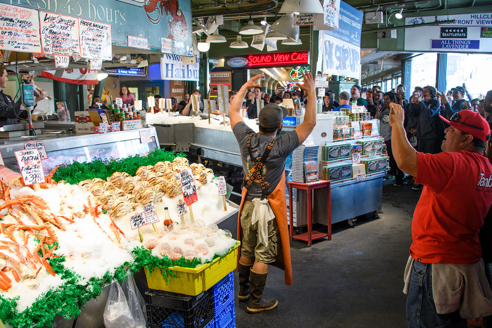 The famous fish markets are part market, part tourist attraction...where the fishmongers toss fish and chant for phone wielding tourists, but on a busy Friday afternoon also wrapped lots of fish for local shoppers.