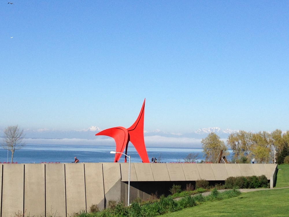 Seattle Art Museum Olympic Sculpture Park with mountain views beyond.