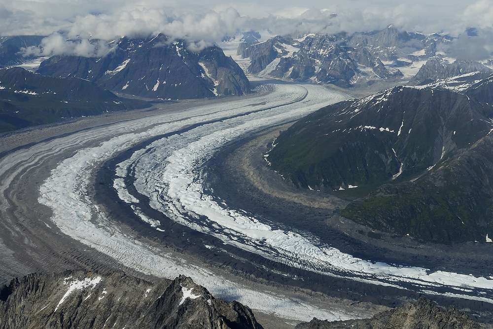 Glaciers look like super highways of ice flowing down the mountains