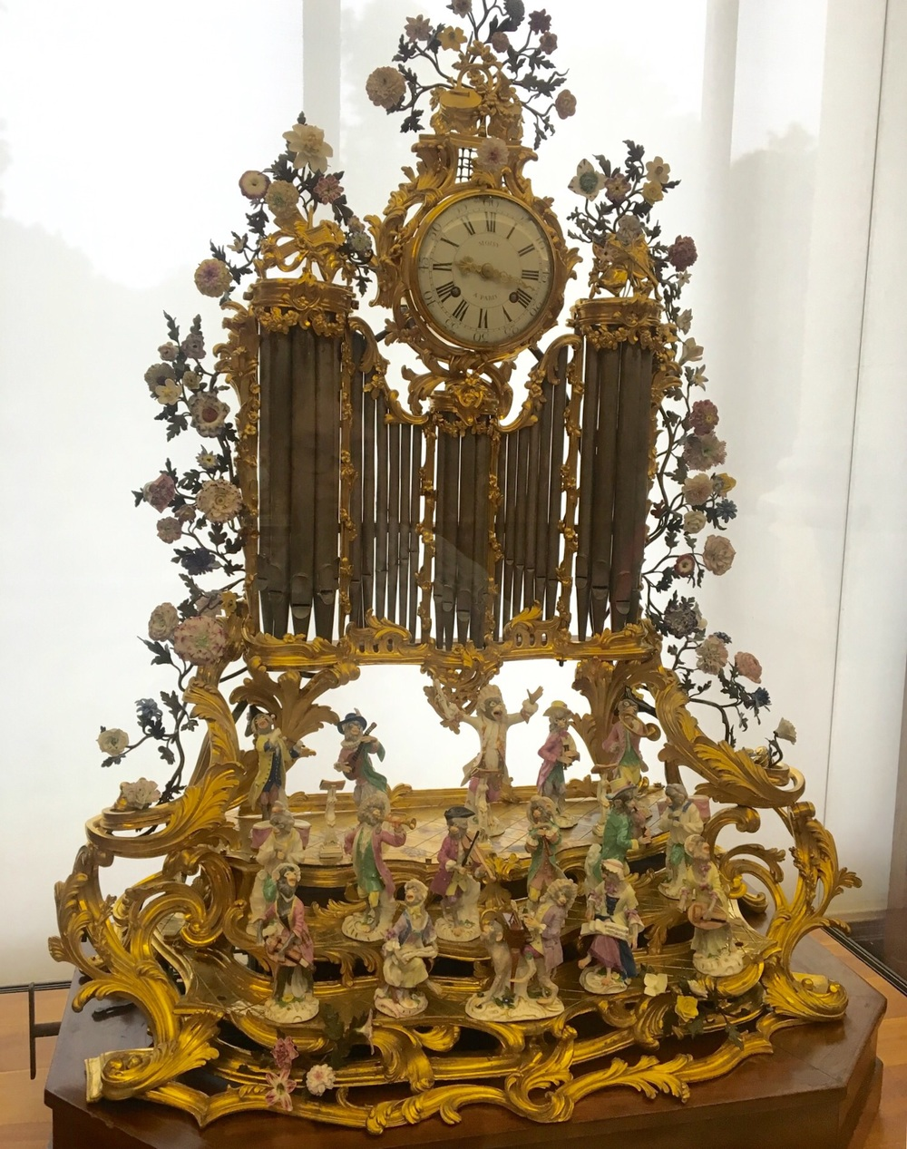 """Trying to help my adult daughter pack reminds me of the saying """"not my circus, not my monkeys"""" - artistically represented here by this Louis the 15th clock at Petit Palais, by multiple artisits, (ceramics by Kandler, Reinicke) depicting an overmatched ceramic monkey band conductor and his """"circus""""."""