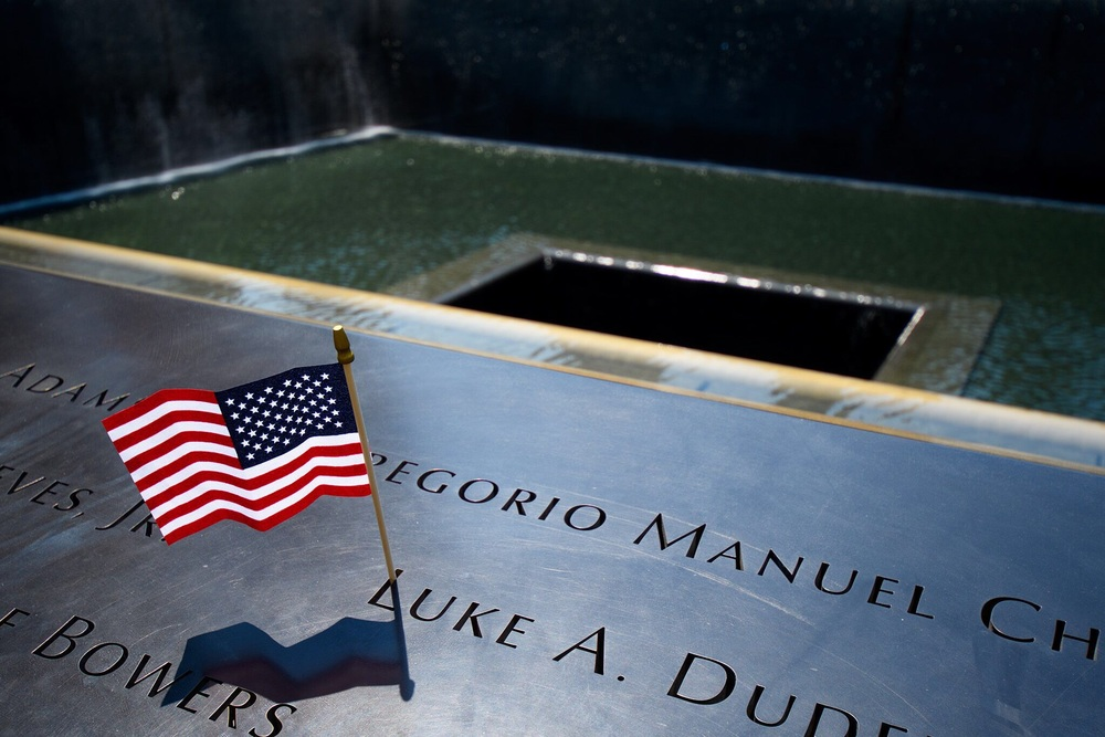 Black granite walls surrounding the falls are engraved with the names of those who were lost in each tower and the plane that hit the tower.