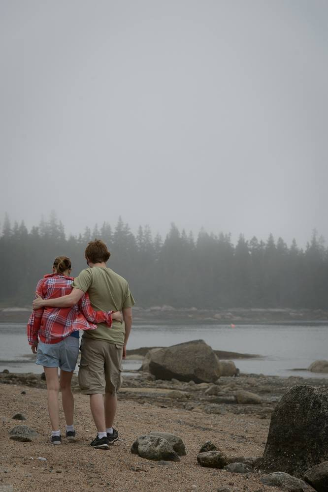 This young couple has the right idea in Maine- focus on eachother and the scenery!